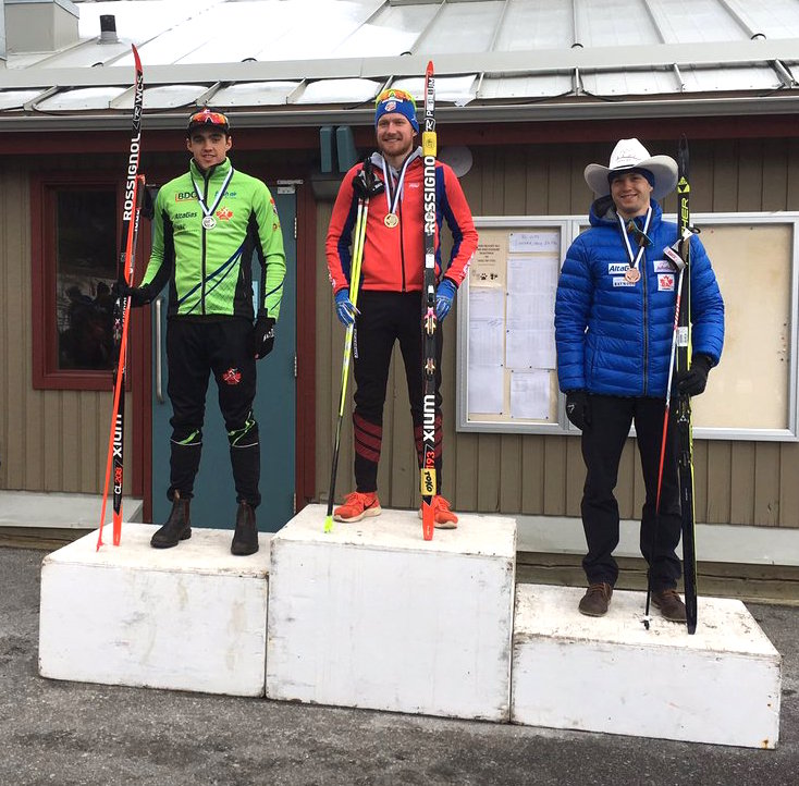 The Alberta Cup men's podium in Sunday's 8.1 k classic interval start, with winner Kyle Bratrud (c) of CXC Team, NDC Thunder Bay's Evan Palmer-Charrette (l) in second and AWCA's Dominique Moncion-Groulx (r) in third. (Photo: NTDC Thunder Bay/Twitter)