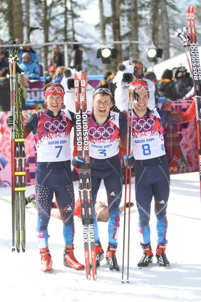 Alexander Legkov (center) and Maxim Vylegzhanin (left) are among the skiers served provisional suspensions for doping violations at the 2014 Olympics. Along with Ilia Chernousov (right, not suspended), they swept the 50 k mass start in Sochi.