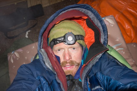 I take a selfie as I prepare to go to sleep in the bear-trashed cabin in Chisana. Photo: Seth Adams