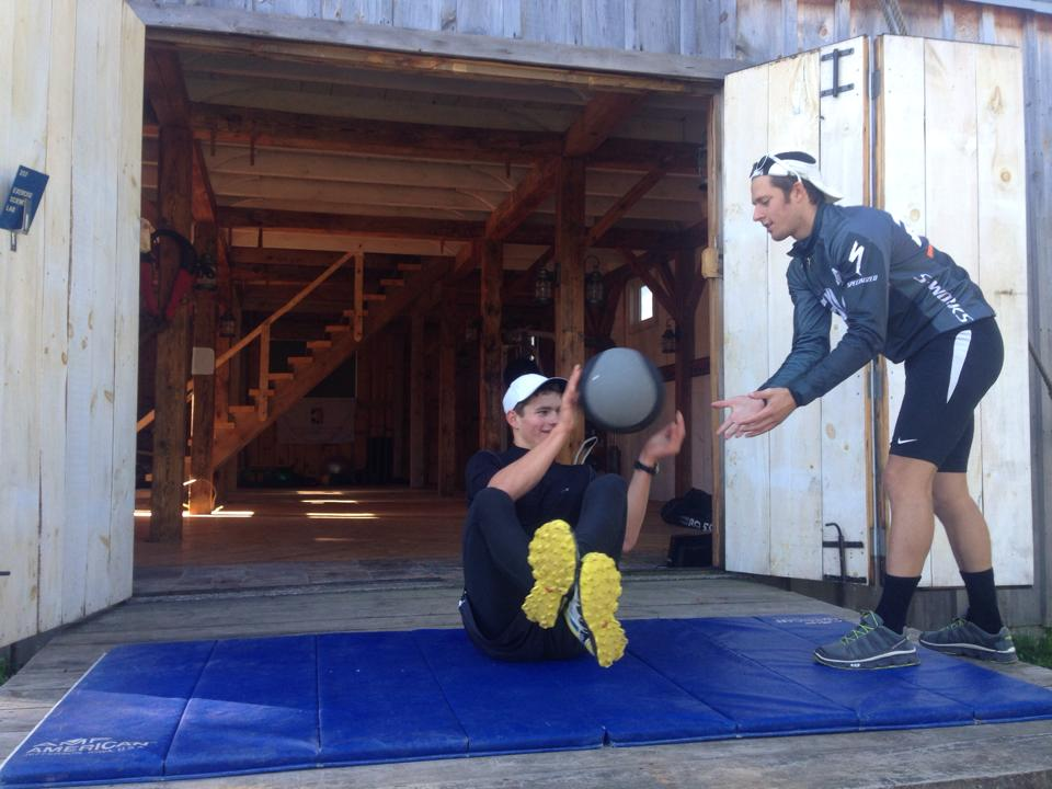 The newly appointed CXC Team Head Coach Andy Keller (r) functions on power with an athlete outdoors a barn near Cable, Wis. (Photograph: CXC/Facebook)