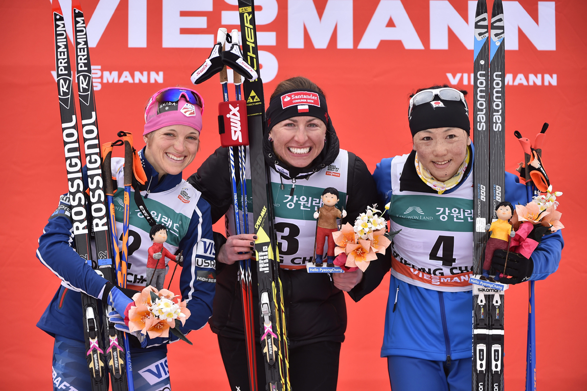 The women's World Cup 15 k skiathlon podium on Saturday in PyeongChang, South Korea, with Poland's Justyna Kowalczyk (c) in first, American Liz Stephen (l) in second, and Japan's Masako Ishida (r) in third. (Photo: Fischer/NordicFocus)