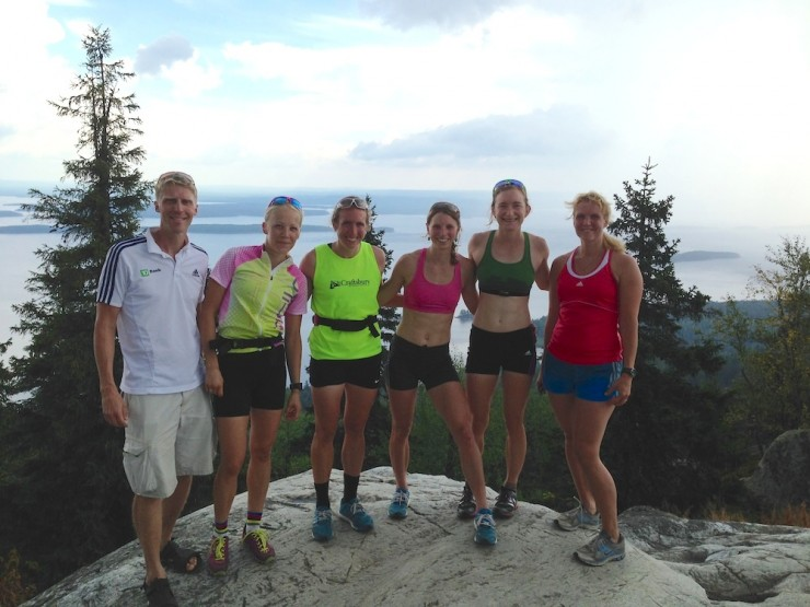 The U.S Biathlon women's staff right after an uphill interval session up Koli, the highest level in southern Finland, with coach Jonne Kähkönen (l) and his wife (r), who also rollerskied up, and Finnish Globe Cup champion Kaisa Mäkäräinen (second from l). (Photograph: Jonne Kähkönen)