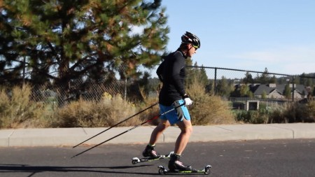 Dave Cieslowski uses a therapy band above his knees to help cues the glutes to fire while skate/roller skiing.