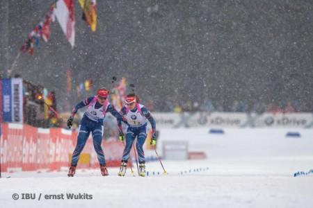 Gabriela Soukalova (l) tagging Czech teammate Jitka Landova in 1st in the women's 4 x six k relay at the Ruhpolding IBU Globe Cup on Thursday in Germany. (Photograph: IBU/Ernst Wukits)