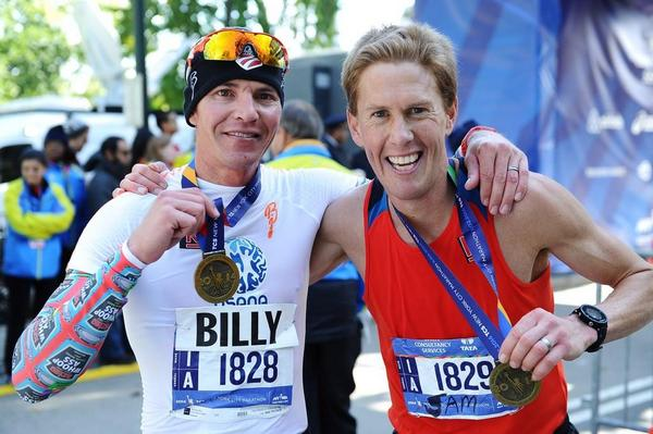 Billy Demong (US Nordic Combined) and good friend Sam Krieg (r) pose following finishing the 2014 NYC Marathon. Demong placed 52nd with a time of 2:33:06. (Photograph: Drea Braxmeier, NYRR)