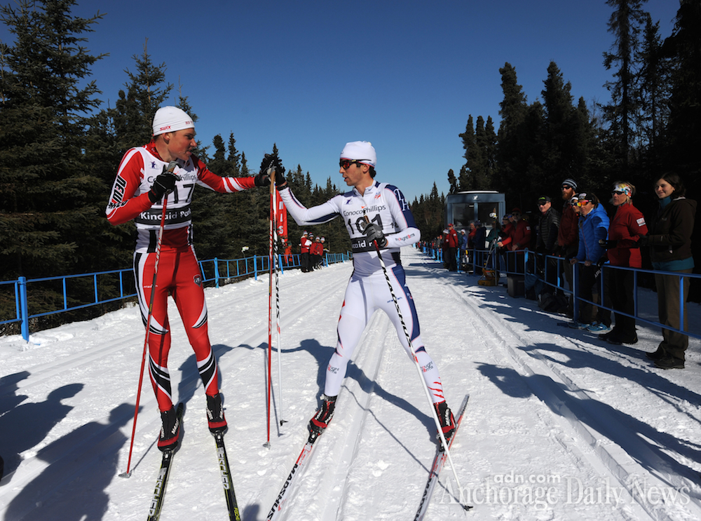 Winner Aku Nikander of the University of New Mexico (l) and runner-up and first American Noah Hoffman of the U.S. Ski Team congratulate each other after finishing the men's 50 k classic race at U.S. Distance Nationals on Friday. (Photo: Erik Hill/Anchorage Daily News)