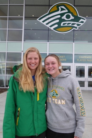 University of Alaska Anchorage Seawolves skiers Hailey Swirbul (l) and Casey Wright (r), photographed on the UAA campus in Anchorage, Alaska, in October 2016. (Photo: Gavin Kentch)