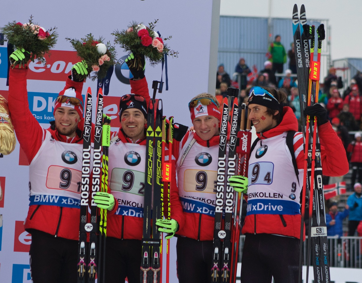 The Canadian men's team (l-r) Christian Gow, Nathan Smith, Scott Gow, and Brendan Green celebrate bronze in the men's 4 x 7.five k relay at 2016 Globe Championships in Oslo, Norway. (Photo: JoJo Baldus)