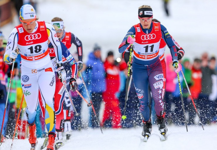 Jessie Diggins (11) throughout her quarterfinal of the one.two k traditional sprint at Stage 4 of the Tour de Ski in Oberstdorf, Germany. The American placed fifth following crashing with Hanna Falk (18). (Photo: Marcel Hilger)