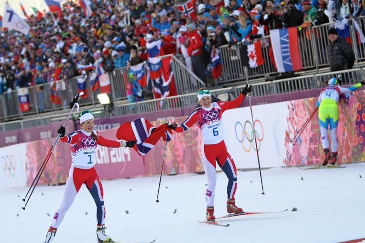Norwegian teammates and close friends Maiken Caspersen Falla (l) and Ingvild Flugstad Østberg celebrate gold and silver, respectively, in Tuesday's Olympic skate sprint in Sochi, Russia.