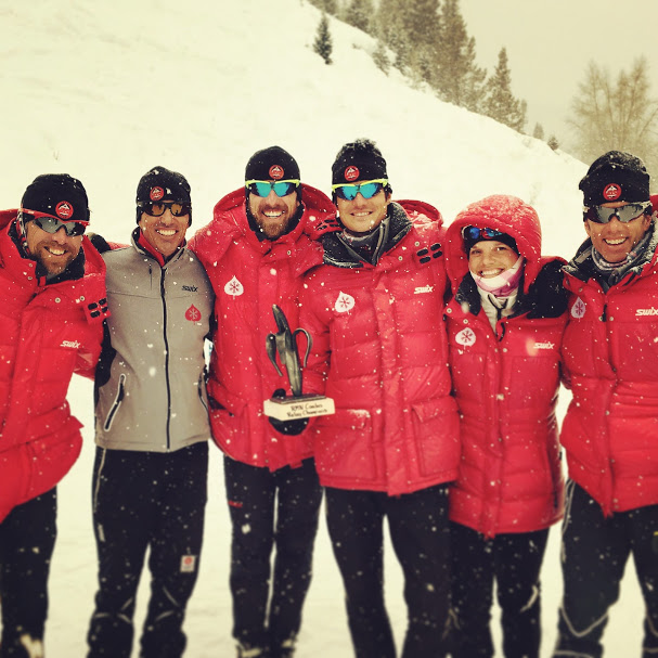 Stuber and Cook (second and third from right) with AVSC staff at a competition this winter. (Courtesy photo)