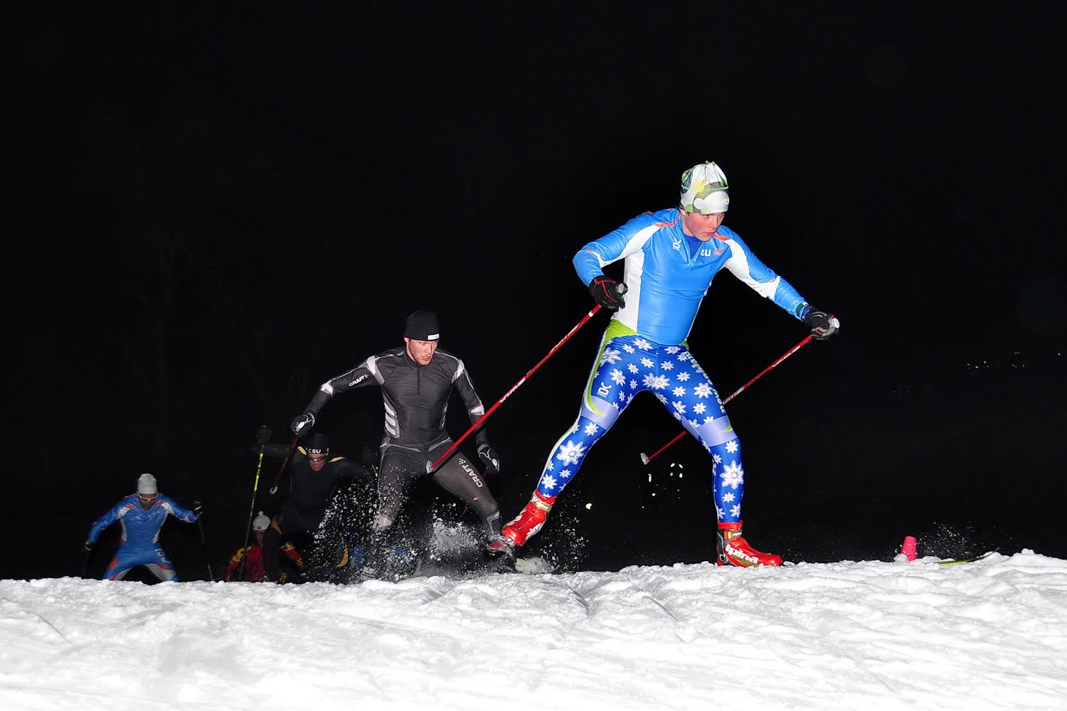 Hamish McEwen and Ian Situation train on the illuminated Weston Ski Track in Weston, Mass. (Photograph: Jamie Doucett)