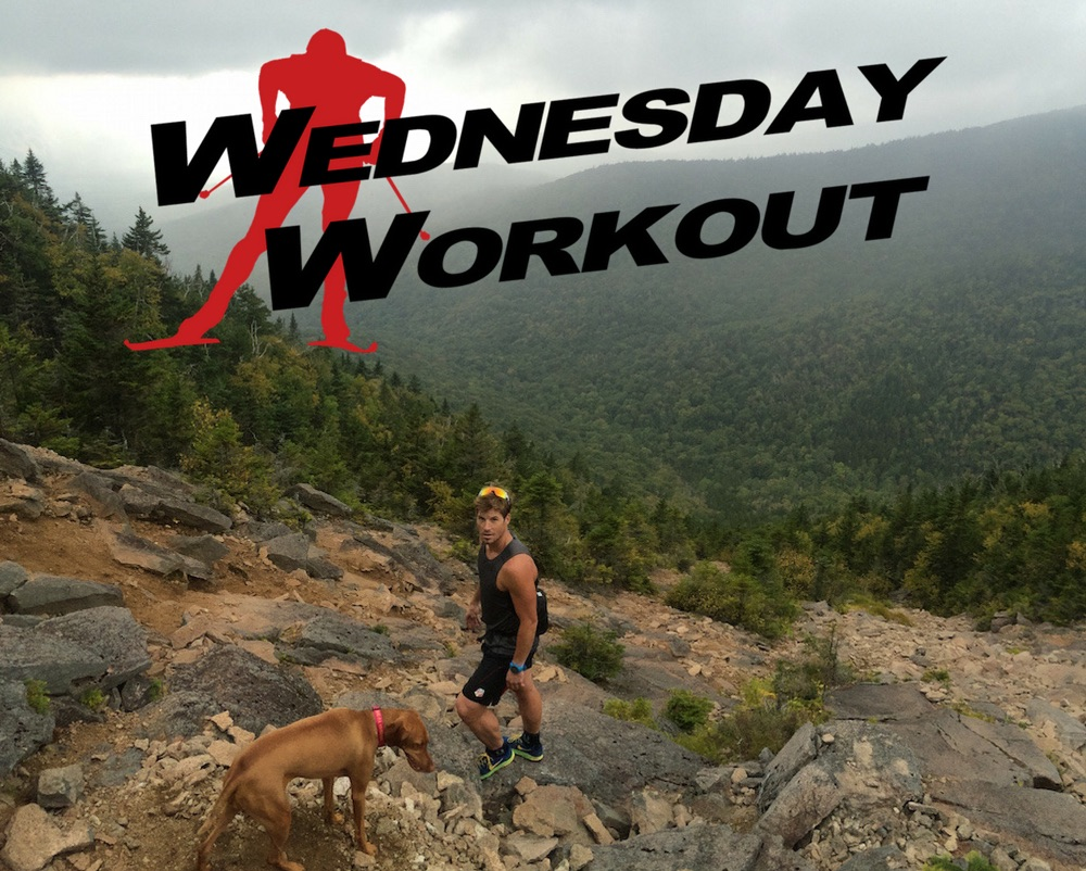 Kris Freeman and his dog She-Ra (along with Tad Elliott -- not shown) racing the rain up to the top of North Slide on Mt. Tripyramid in Waterville Valley, N.H., on Sept. 14. (Photo: Tad Elliott)
