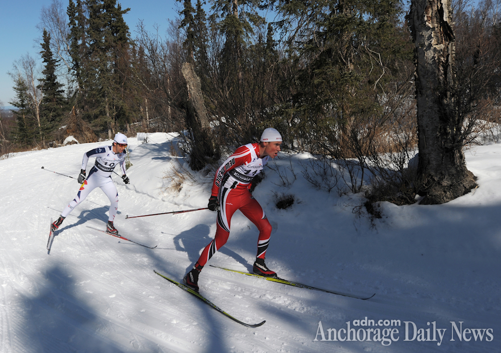 Finnish skier Aku Nikander (r) of the University of New Mexico leads Noah Hoffman of the U.S. Ski Team around a corner on the Spencer Loop during the final lap of the men's 50 k classic race at the U.S. Distance Nationals at Hillside in Anchorage, Alaska. (Photo: Erik Hill/Anchorage Daily News)