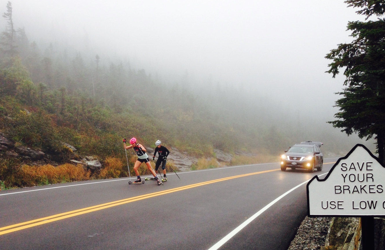 Mary Rose (SVSEF) leads US Biathlon's Annelies Cook up the Whiteface Mountain toll street for the duration of the yearly Climb to the Castle. Rose won and Cook completed second, 32 seconds later on. (Photo: Tim Cowan)