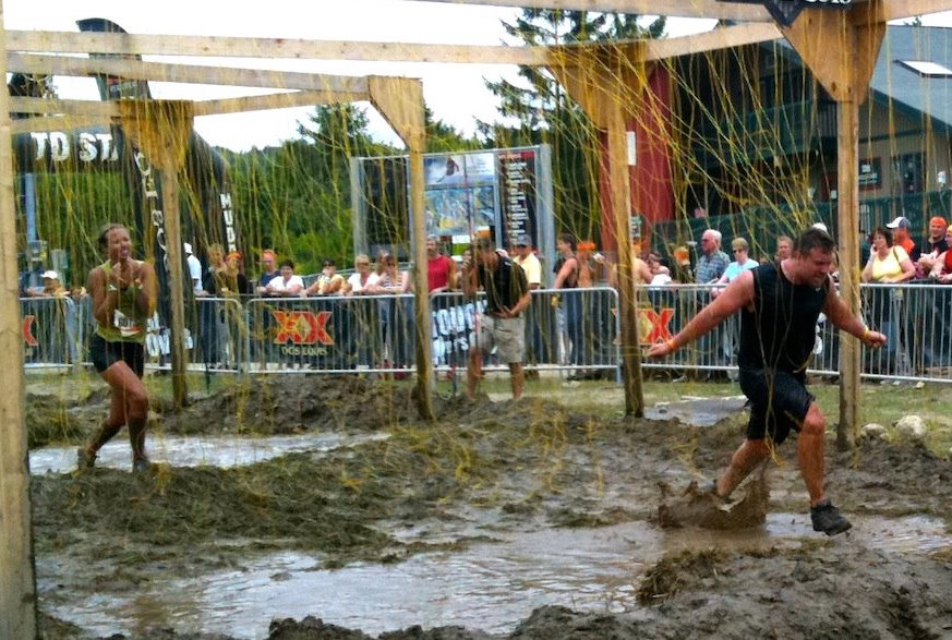 "Something like this 2012 photo of FasterSkier editor Alex Kochon (l) and her brother running through a Tough Mudder ""Electroshock Therapy"" obstacle will work."