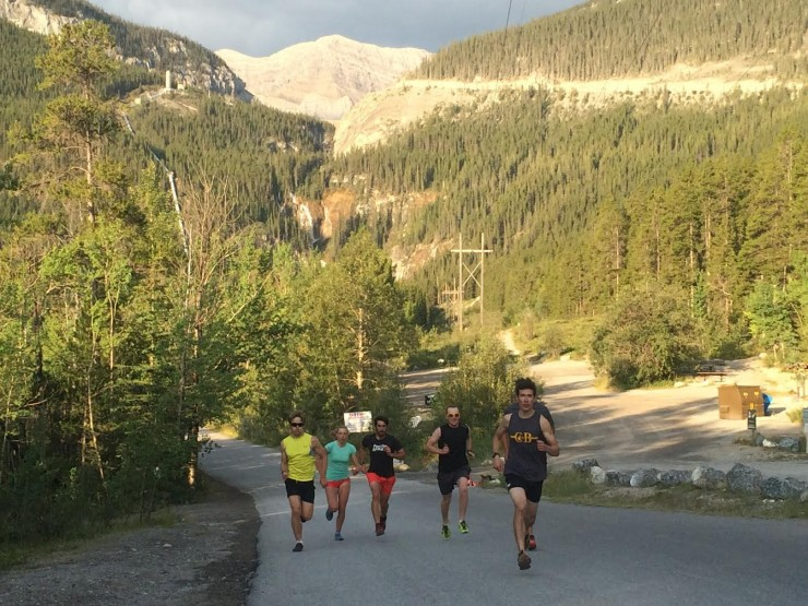 WinSport Junior XC Group athletes (from left to correct) Peter Hicks, Morgan Rogers, Jasper Mackenzie, Eric Byram, Ewan Craig, and Alec Stapff push up a hill on Spray Lakes Road in Canmore, Alberta, in the course of an intensity workout following a prolonged block of volume. (Photo: Eric de Nys)