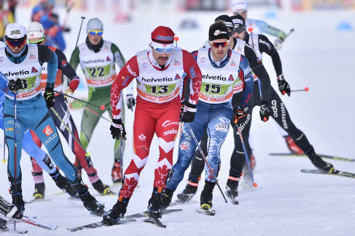 Canada's Alex Harvey (13) leading American Simi Hamilton (15) among others in the men's 6 x 1.3 k freestyle team sprint on Sunday at the World Cup in Toblach, Italy. (Photo: Salomon/Nordic Focus)