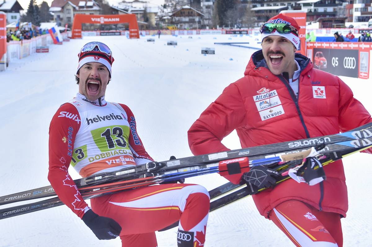 Canada's Alex Harvey (l) and Len Valjas celebrate their World Cup freestyle team sprint win on Sunday in Toblach, Italy. It was the first team-sprint victory for Canada since 2011 World Championships. (Photo: Salomon/NordicFocus)
