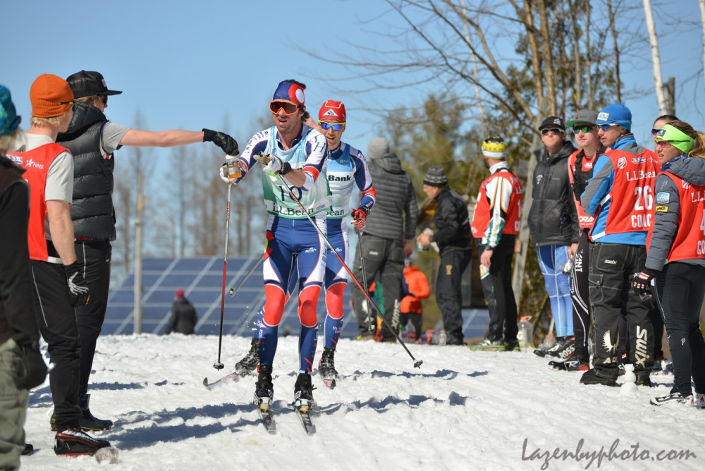 Tad Elliott of Ski and Snowboard Club Vail (l) receives a feed ahead of Noah Hoffman Ski and Snowboard Club Vail in the course of the men's 50 k at 2016 U.S. Distance Nationals on Saturday in Craftsbury, Vt. (Photograph: John Lazenby/Lazenbyphoto.com)
