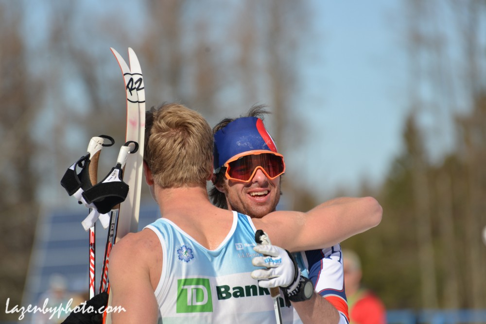 Second area finisher, Tad Elliott of Ski and Snowboard Club Vail (l) receives a hug from 1st location finisher, Erik Bjornsen of Alaska Pacific University after the men's 50 k at 2016 U.S. Distance Nationals on Saturday in Craftsbury, Vt. (Photograph: John Lazenby/Lazenbyphoto.com)