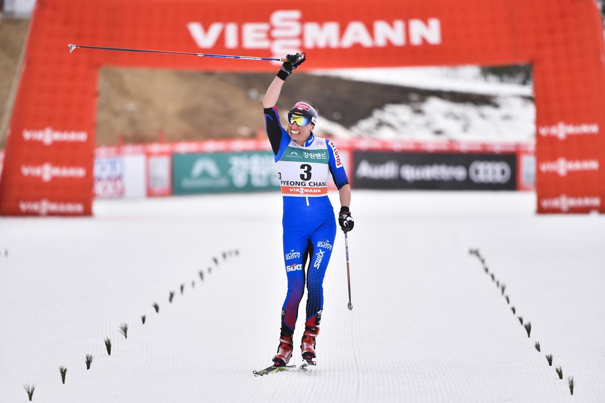 Poland's Justyna Kowalczyk winning her first World Cup in three years on Saturday, the women's 15 k skiathlon at in PyeongChang, South Korea. (Photo: Fischer/Nordic Focus)