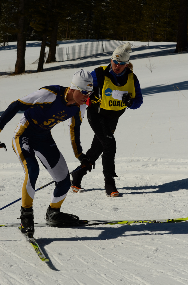 Gethe Hagensen runs along former Montana State University athlete Tyler Reinking in the 2012 NCAA Championship in Bozeman, Mont. Grethe was head nordic coach at the university for a decade. (Photo: Stuart Jennings)