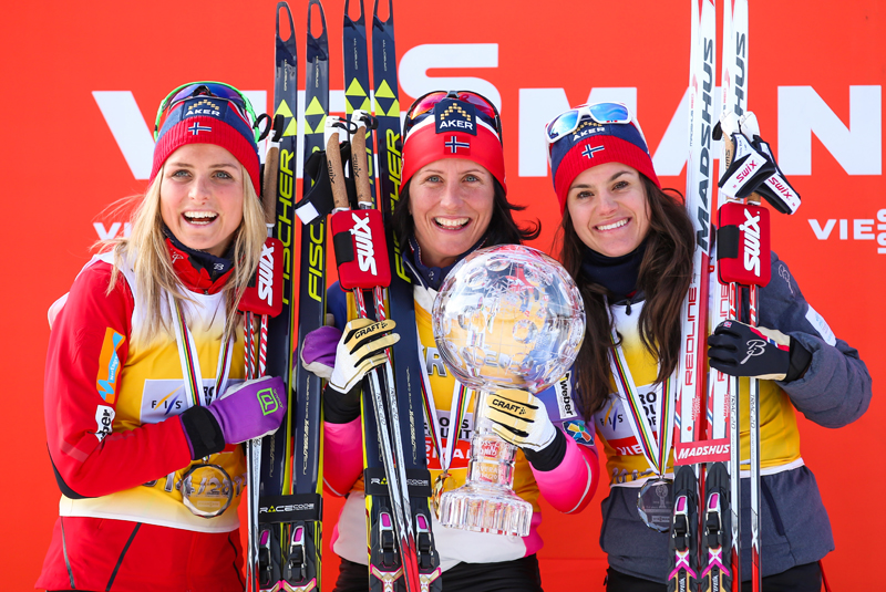 Marit Bjørgen won the overall FIS World Cup title for the fourth time in 2014-2015, also taking home the Sprint Cup and Distance Cup globes. Along with Therese Johaug, who won it in 2015-2016 (left) and Heidi Weng, she trains more than you. (Photo: Fischer/NordicFocus.com)