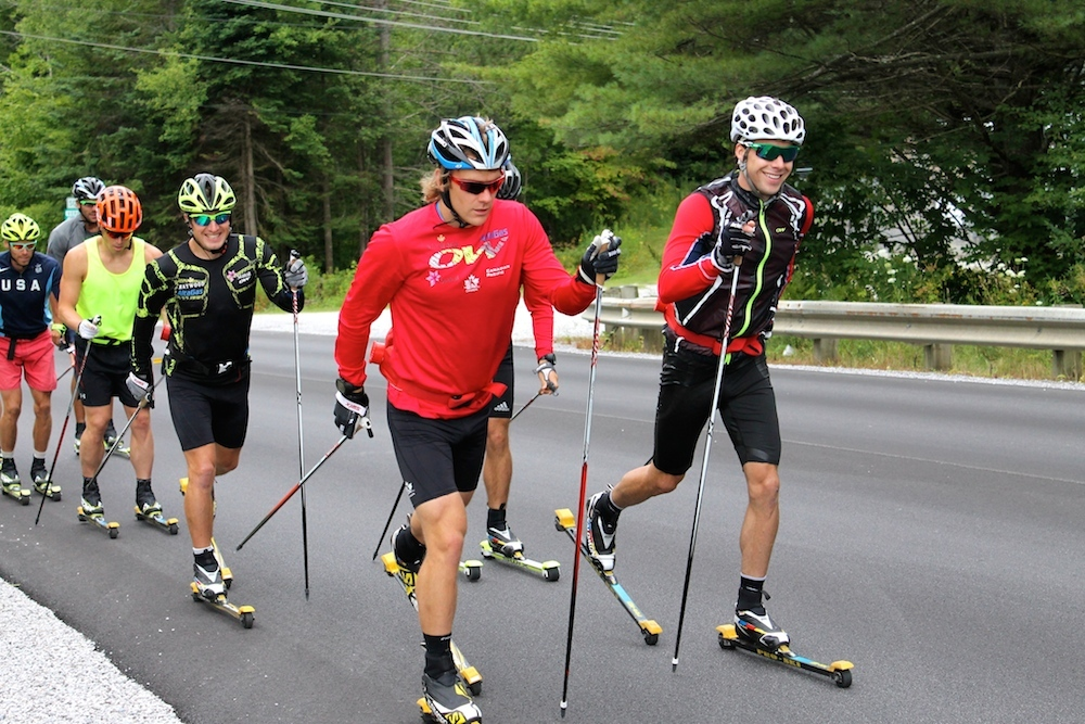 Canadians Alex Harvey (r), Devon Kershaw (front left) lead 6 others, which includes Ivan Babikov (third from l), Kris Freeman (second from l) and Andy Newell (l), during a combi over-distance rollerski near Stratton, Vt.