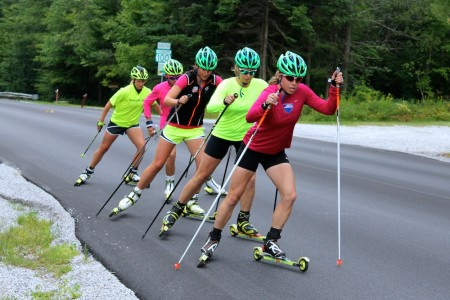 APU's Rosie Brennan prospects Stratton skiers for the duration of a above-distance, combi rollerski in Stratton, Vt.