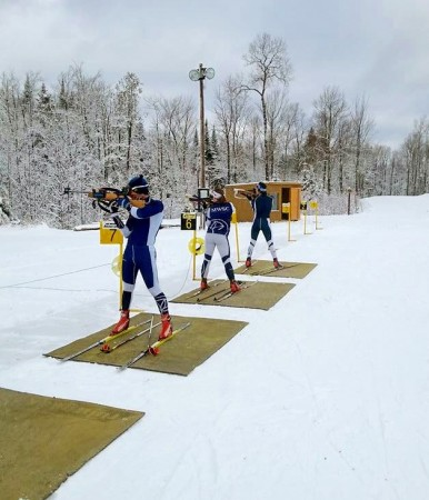 Left to right: MWSC Biathletes Brendan Cyr, Mikaela Paluszek, and elite athlete Russell Currier during a head-to-head shooting workout in late December at the Fort Kent Outdoor Center in Fort Kent, Maine, Dec., 2015. (Courtesy photo)