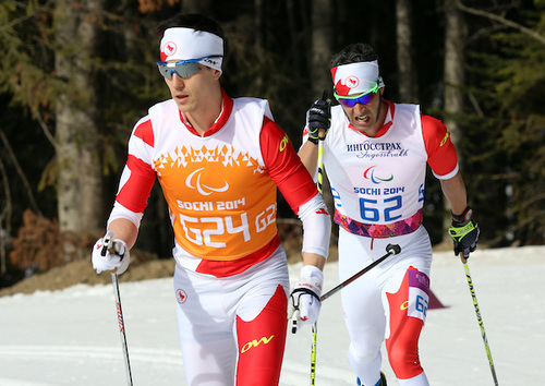 Graham Nishikawa pacing Brian McKeever to his eighth Paralympic gold on Monday in the 20 k visually impaired classic race in Sochi, Russia. McKeever used both Nishikawa and Erik Carleton as guides, switching halfway through the distance race. (Photo Scott Grant/Canadian Paralympic Committee)