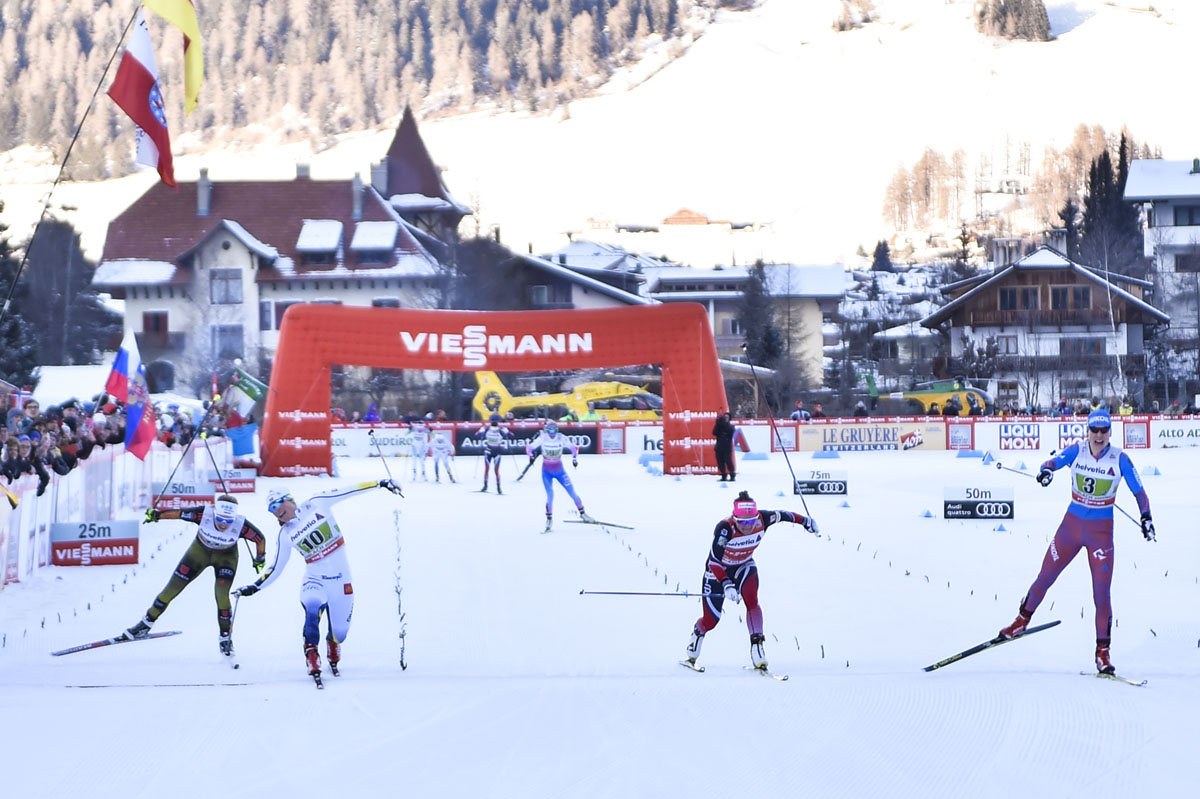 Russia's Natalia Matveeva (r) winning a three-way photo finish for first in the women's freestyle team sprint on Sunday in Toblach, Italy, ahead of Sweden's Hanna Falk (in white), who placed second (+0.04), and Norway's Maiken Caspersen Falla (second from l), who ended up third (+0.11), respectively. (Photo: Fischer/NordicFocus)