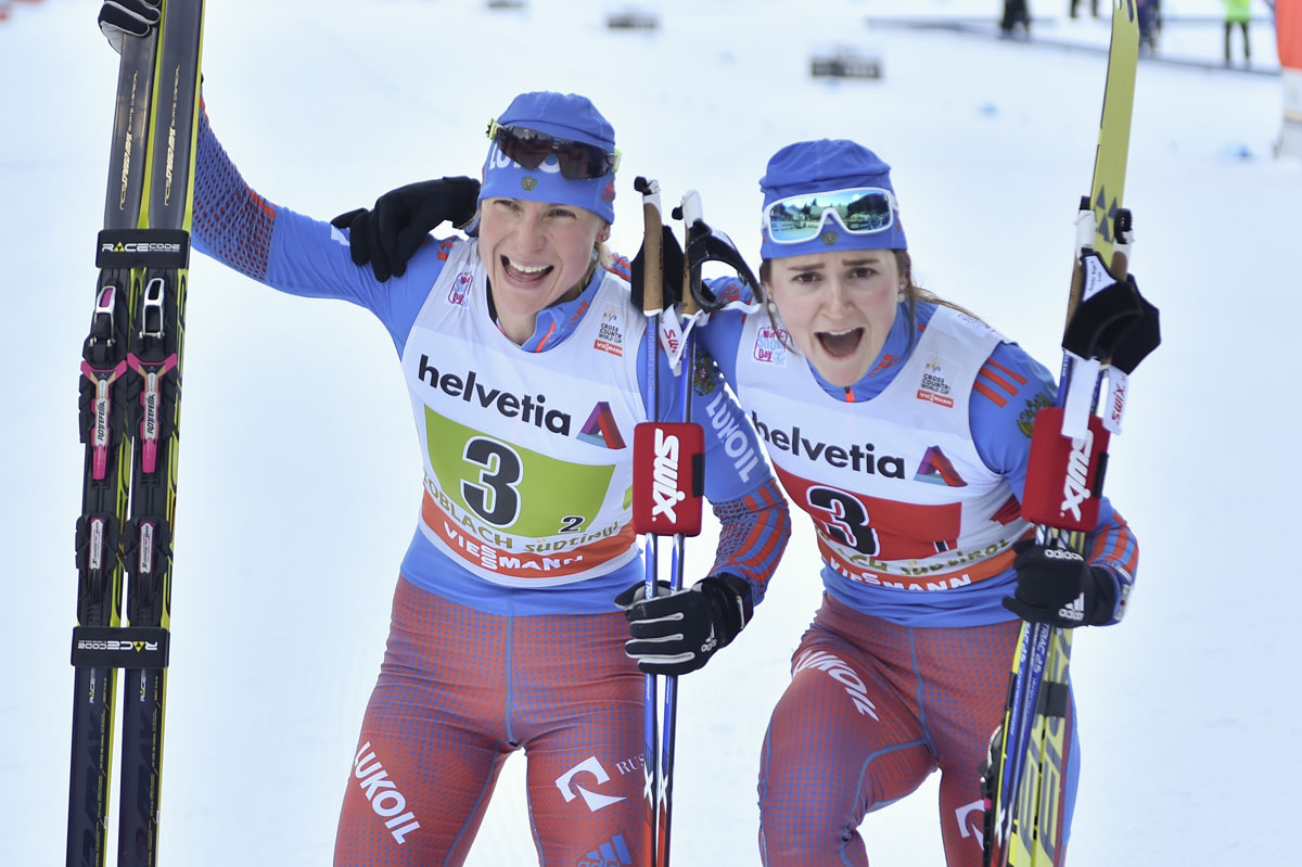 Russia's Natalia Matveeva (l) and Yulia Belorukova celebrating Belorukova's first World Cup victory and Matveeva's second-straight win after Sunday's freestyle team sprint in Toblach, Italy. (Photo: Fischer/NordicFocus)