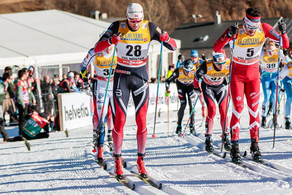 Norway's Niklas Dyrhaug (28) and Canada's Alex Harvey (r) racing toward the front of the pack in the men's 10 k classic mass start at Stage 2 of the Tour de Ski on Sunday in Val Mustair, Switzerland. Harvey went on to finish eighth while Dyrhaug placed 12th. (Photo: Fischer/NordicFocus)