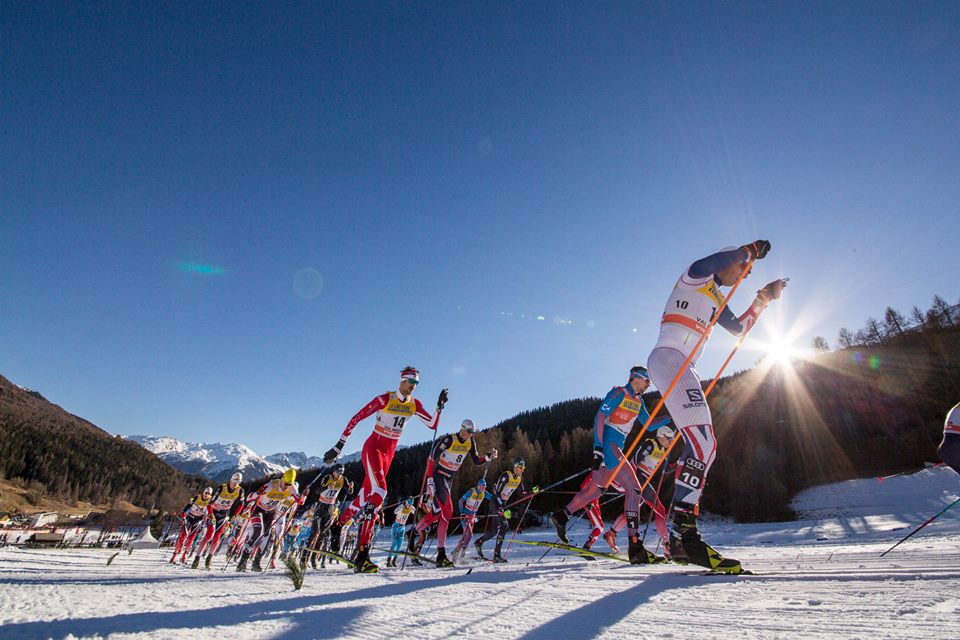 Canada's Len Valjas (in red) striding near Russia's Sergey Ustiugov (second from r, in blue) in Sunday's 10 k classic mass start at Stage 2 of the Tour de Ski in Val Mustair, Switzerland. According to Valjas's teammate Alex Harvey, most of the top skiers chose to stride rather than double pole, but Great Britain's Andrew Young (r) was among those double poling on skate skis. He ended up 50th, while his teammate Andrew Musgrave double poled to 17th. (Photo: Fischer/NordicFocus)
