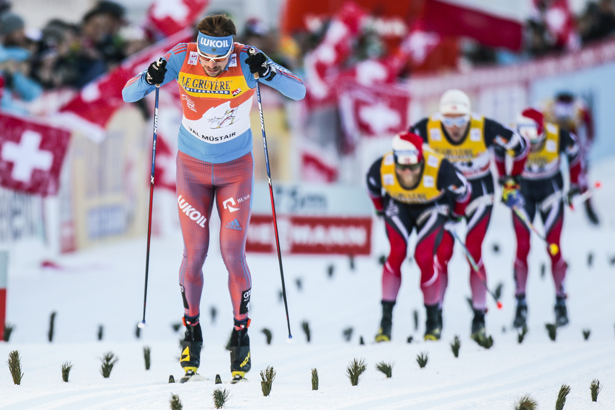 Russia's Sergey Ustiugov racing to the 10 k classic mass start win by 1.9 seconds over Norway's runner-up Martin Johnsrud Sundby (second from r) and 2.3 seconds over Norway's Didrik Tønseth (r) in third on Sunday at Stage 2 of the Tour de Ski in Val Mustair, Switzerland. (Photo: Fischer/NordicFocus)