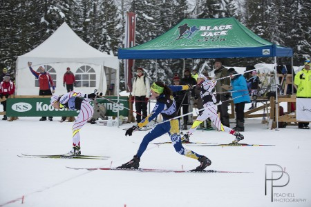Emily Nishikawa (l) edges Olivia Bouffard-Nesbitt (c) and Heidi Widmer (r) in the women's one.four k skate sprint last at the Black Jack NorAm on Dec. 14 in Rossland, B.C. Widmer was 2nd and Bouffard-Nesbitt placed third. (Photograph: Shelley Peachell/Peachell Photography, http://peachellphotography.com/)