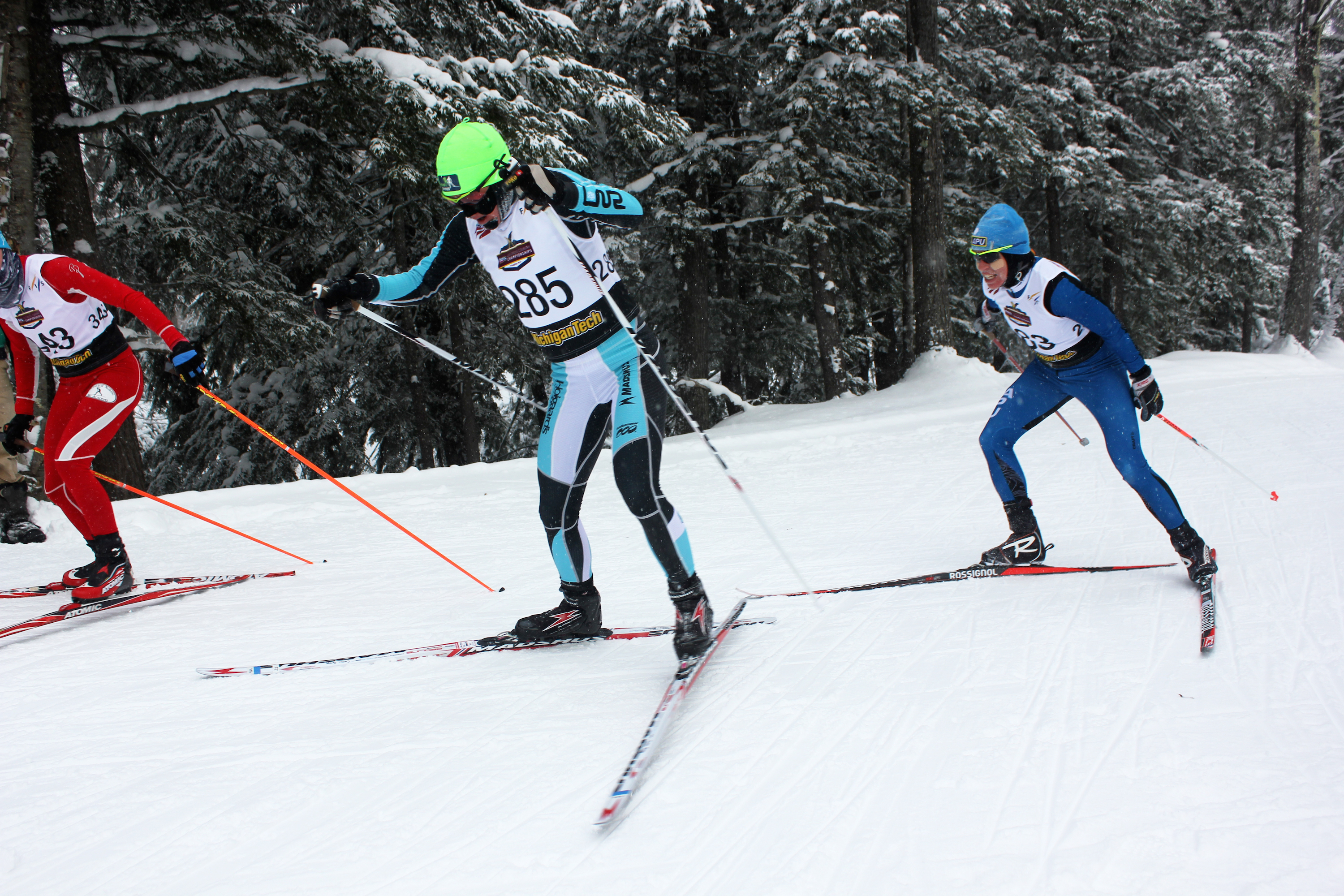 Caitlin Gregg (l) of Team Gregg/Madshus leads Rosie Brennan (r) of APU on in the final lap of the 10 k freestyle at the 2015 U.S. Cross Nation Championships in Houghton, Mich. Gregg won the race, even though Brennan earned third spot.