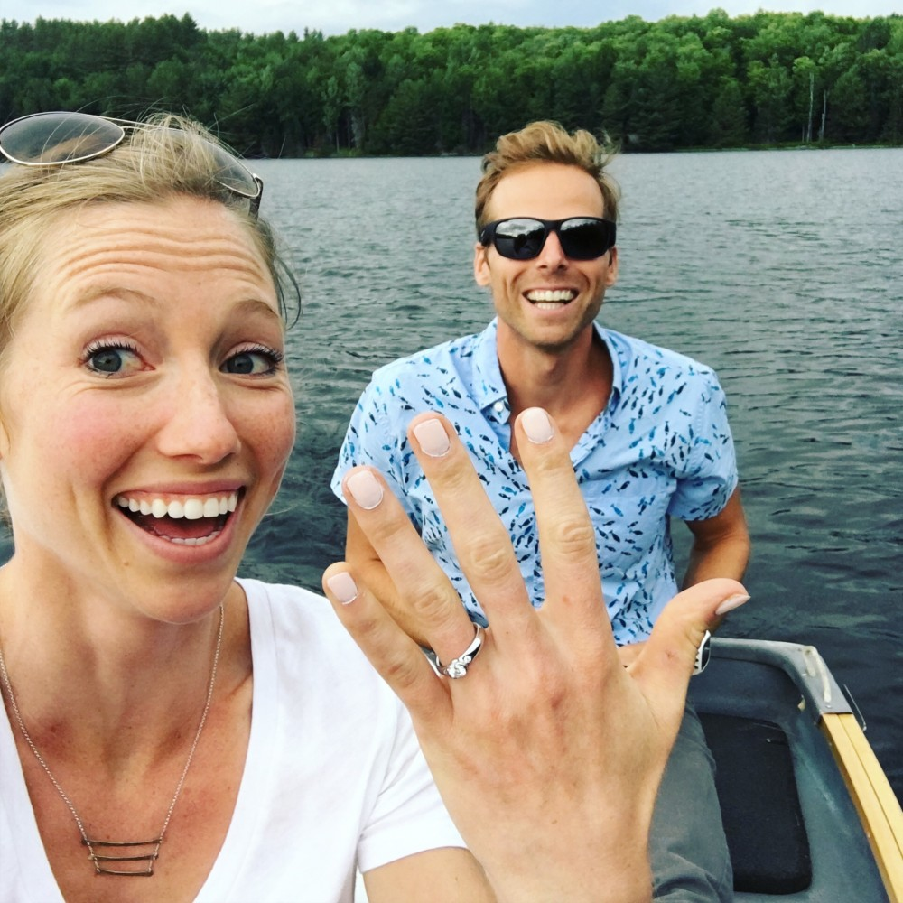 Erika Flowers (l) and Andy Newell flashing smiles on Friday July 1st, while out fishing on Gale Meadows Pond on the date of their engagement. (Courtesy Photo)