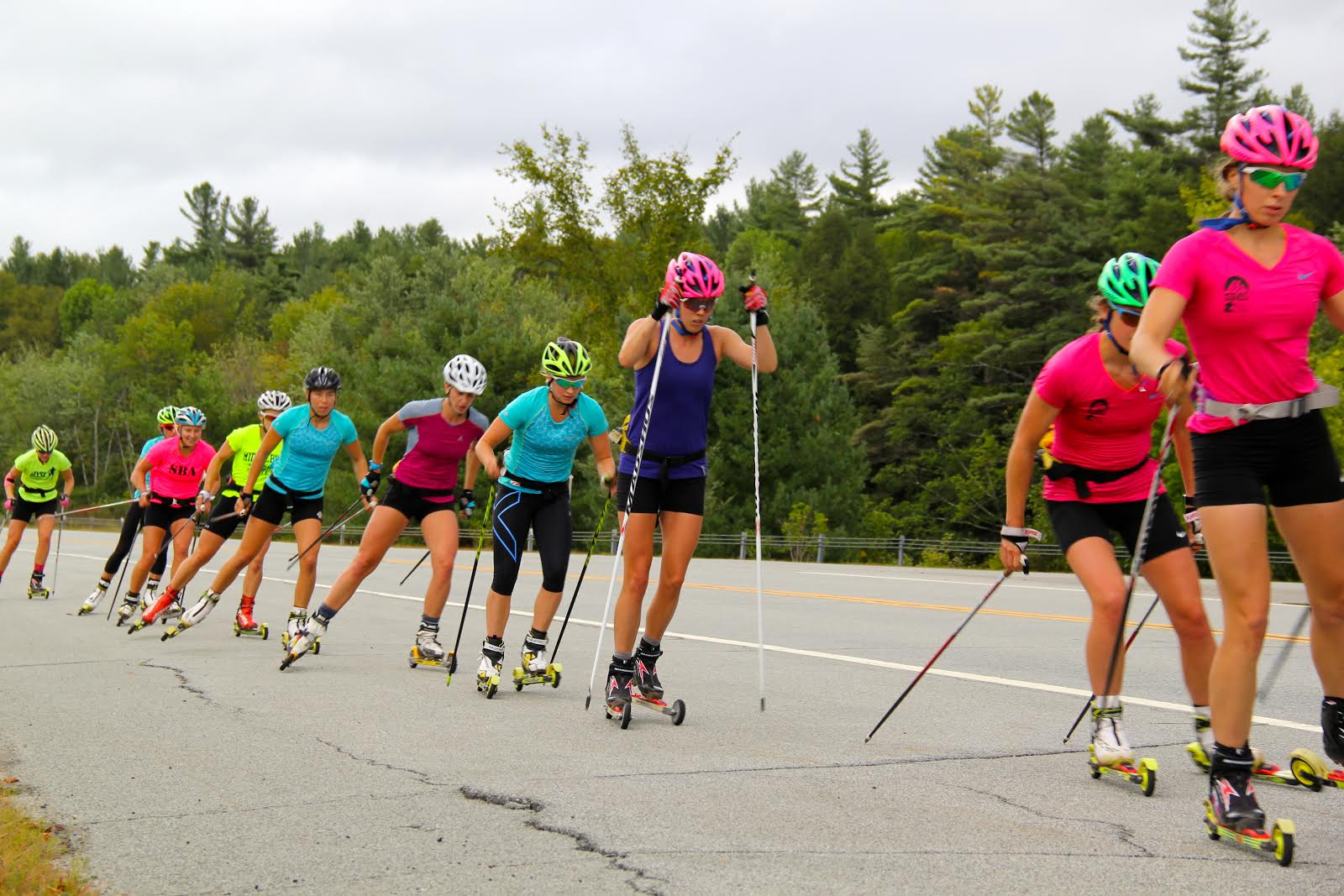 Annie Hart prospects Annie Pokorny, Mary Rose, Jessie Diggins, Deedra Irwin, Katharine Ogden, Kelsey Phinney, Hannah Halvorsen, Sophie Caldwell, and Hailey Swirbul in the course of a rollerski session close to Lake Placid, N.Y. (Photograph: Bryan Fish)