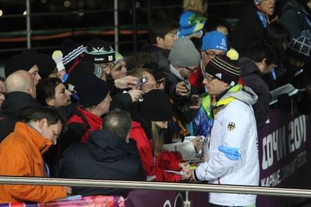 German Ski Association spokesman Stefan Schwarzbach takes questions after Friday's women's relay race.