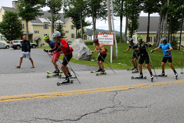 Andy Newell (l) and Alex Harvey (r) lead an over-distance rollerski previous the Stratton Mountain School whilst Canadian coach Tor-Arne Hetland (l) checks in.