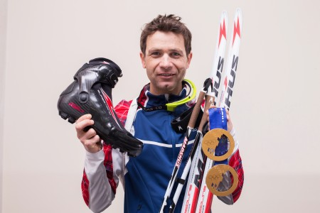 Ole Einar Bjørndalen with his two gold medals from Sochi and the gear that aided him get them. (Photograph: Madshus/NordicFocus)