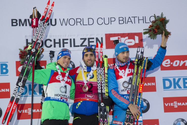 After what runner-up Simon Schempp (l) of Germany referred to as a &quotpsycho race&quot Schempp, winner Martin Fourcade (c) of France, and Russia's Anton Shipulin (r) shared the pursuit podium at the IBU Globe Cup in Hochfilzen, Austria. (Photograph: Fischer/NordicFocus)