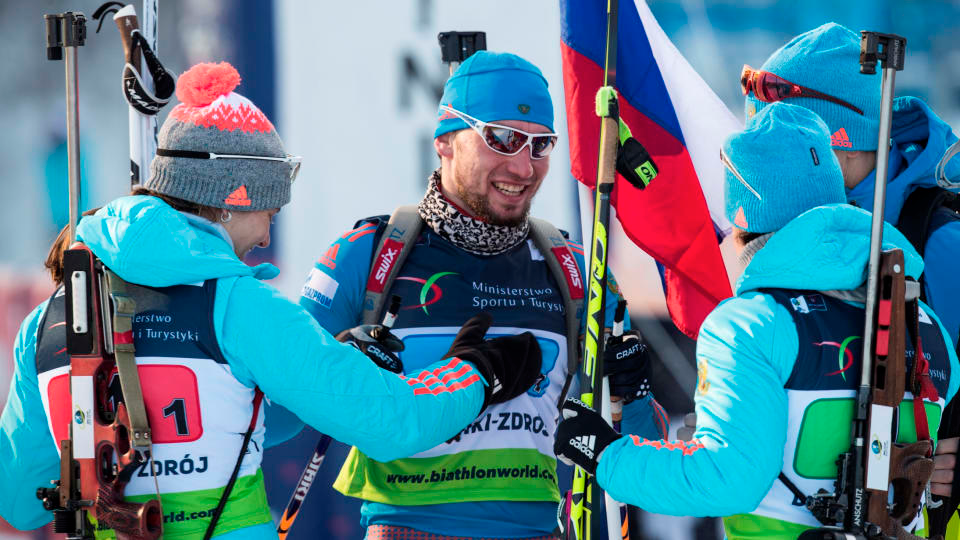 Russia's Alexander Loginov (center) is greeted at the finish by his teammates Irina Starykh, Svetlana Sleptsova and Alexey Volkov after anchoring his team to the gold medal in the mixed relay at the 2017 IBU Open European Championships in Duszniki-Zdrój, Poland. (Photo: IBU)