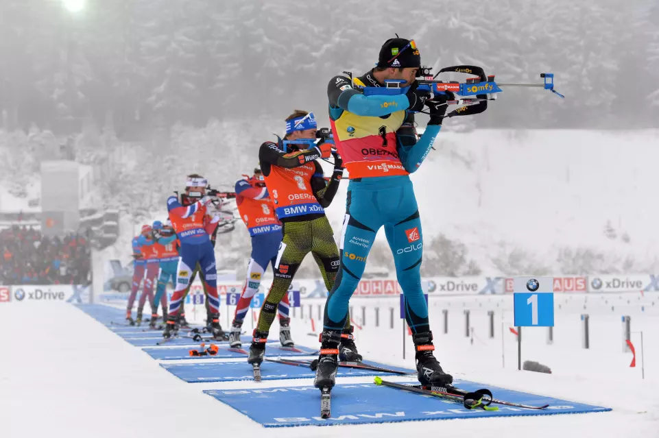 France's Martin Fourcade (bib 1) and Germany's Simon Schempp (bib 3) shooting in the third stage of the men's 15-kilometer mass start at the 2017 IBU World Cup in Oberhof, Germany. (Photo: IBU)